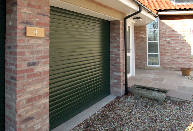 Gliderol  Insulated Automated Roller Garage Door (height 7ft) measuring 8 feet 6 inches wide.